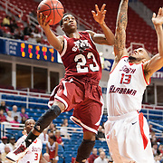 MOBILE, AL - DECEMBER 4:  Daniel Mullings #23 of the New Mexico State Aggies attempts a layup over Mychal Ammons #13 of the South Alabama Jaguars at USA Mitchell Center on December 4, 2012 in Mobile, Alabama. At halftime New Mexico State leads South Alabama 31-25. (Photo by Michael Chang/Getty Images) *** Local Caption *** Daniel Mullings;Mychal Ammons