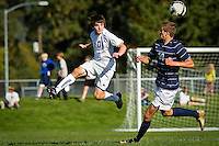 Coeur d'Alene High's Justin Doering remains airborne after making a play on the ball in front of Lake City's Lenny Beckmann during the 5A Region 1 championship game Saturday.
