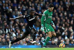 "West Ham United's Michail Antonio (left) and Manchester City goalkeeper Ederson (right) battle for the ball during the Premier League match at the Etihad Stadium, Manchester. PRESS ASSOCIATION Photo. Picture date: Sunday December 3, 2017. See PA story SOCCER Man City. Photo credit should read: Martin Rickett/PA Wire. RESTRICTIONS: EDITORIAL USE ONLY No use with unauthorised audio, video, data, fixture lists, club/league logos or ""live"" services. Online in-match use limited to 75 images, no video emulation. No use in betting, games or single club/league/player publications."