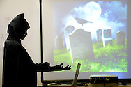 Kyle Tevlin dresses as the grim reaper to start her fun funeral planning class Wednesday, October 19, 2016 at Keith Valley Middle School in Horsham, Pennsylvania. Devlin runs a Devon-based, personal-planning business that finds creative ways to hold funerals and memorials at places that meant something to the deceased, whether that's a beach or a bar. (WILLIAM THOMAS CAIN / For The Philadelphia Inquirer)