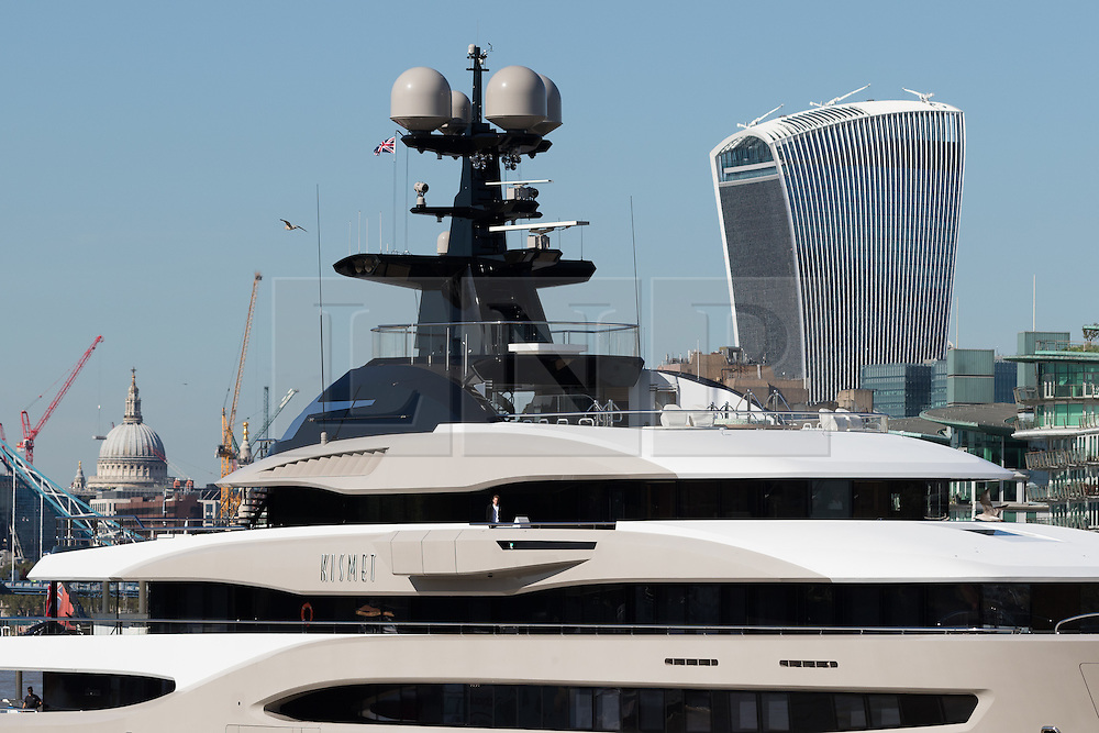© Licensed to London News Pictures. 03/10/2016. LONDON, UK.  Superyacht, Kismet leaves London on the River Thames passing in front of St Paul's Cathedral and the Walkie Talkie skyscraper during blue skies and sunny autumn weather this lunchtime, after mooring at Butlers Wharf last week. Kismet is 308 feet long and is reportedly owned by Pakistani-American billionaire Shahid Khan, who owns the National Football League (NFL) team, the Jacksonville Jaguars, who played the Colts in an International Series game at Wembley yesterday. Kismet has 6 staterooms, with the master bedroom having its own private deck with jacuzzi and helipad and can be chartered for an estimated £1m per week. Photo credit: Vickie Flores/LNP