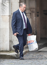 © Licensed to London News Pictures. 09/09/2019. London, UK. Conservative MP Liam Fox carries a Tesco shopping bag as he arrives at Parliament. The government have announced that Parliament will be prorogued at the end of business today. Photo credit: Peter Macdiarmid/LNP