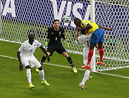 Michael Arroyo of Ecuador (R) heads over Lucas Digne of France (17) saved by Hugo Lloris of France (black) during the 2014 FIFA World Cup Group E match at Maracana Stadium, Rio de Janeiro<br /> Picture by Andrew Tobin/Focus Images Ltd +44 7710 761829<br /> 25/06/2014