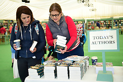 © London News Pictures. 26/05/2016. Hay on Wye, UK. The opening day of the Hay Festival 2016, and some early visitors are already buying books from the bookshop  on the festival site. Photo credit: Keith Morris/LNP