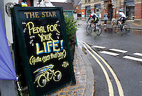 RideLondon cyclists pass The Star pub with the helpful sign of 'Pedal for your Life' advice in Dorking Town Centre<br /> <br /> Prudential RideLondon, the world&rsquo;s greatest festival of cycling, involving 70,000+ cyclists &ndash; from Olympic champions to a free family fun ride - riding in five events over closed roads in London and Surrey over the weekend of 9th and 10th August. <br /> <br /> Photo: Jed Leicester for Prudential RideLondon<br /> <br /> See www.PrudentialRideLondon.co.uk for more.<br /> <br /> For further information: Penny Dain 07799 170433<br /> pennyd@ridelondon.co.uk