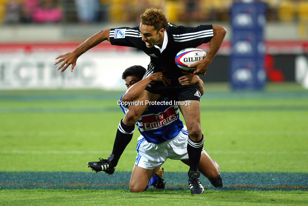 06 February 2004, Westpac Stadium, Wellington, IRB New Zealand Sevens.<br />New Zealand vs Samoa<br />New Zealand's Brad Fleming gets tackled during New Zealand's 21-7 win over Samoa on Friday.<br />Please Credit: Marty Melville/Photosport