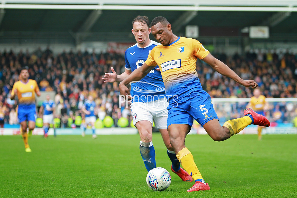\Mansfield Town defender Krystian Pearce (5) clears from Chesterfield forward Kristian Dennis (9)  during the EFL Sky Bet League 2 match between Chesterfield and Mansfield Town at the Proact stadium, Chesterfield, England on 14 A pril 2018. Picture by Nigel Cole.