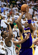Los Angeles Lakers guard Kobe Bryant, right, shoots a three-point shot as Utah Jazz guard Wesley Matthews, left, defends during the second half of Game 3 of the NBA Western Conference second-round playoff series in Salt Lake City, Saturday, May 8, 2010. (AP Photo/Colin E Braley)