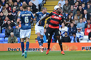 Queens Park Rangers striker Jay Emmanuel-Thomas beats Birmingham City defender Paul Robinson to a header during the Sky Bet Championship match between Birmingham City and Queens Park Rangers at St Andrews, Birmingham, England on 17 October 2015. Photo by Alan Franklin.