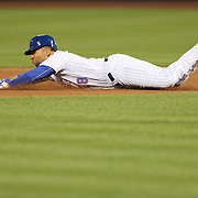 NEW YORK, NEW YORK - July 27:  James Loney #28 of the New York Mets dives safely into second base after a deflected infield single by Neil Walker #20 of the New York Mets during the St. Louis Cardinals Vs New York Mets regular season MLB game at Citi Field on July 27, 2016 in New York City. (Photo by Tim Clayton/Corbis via Getty Images)