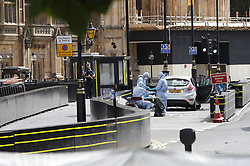 © Licensed to London News Pictures. 14/08/2018. London, UK. Police forensics officers examine a car that crashed into security barriers outside Parliament. A man had been arrested. A number of people are injured. Photo credit: Peter Macdiarmid/LNP