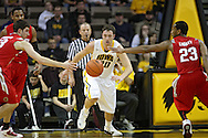 January 04 2010: Ohio State Buckeyes guard Jon Diebler (33), Iowa Hawkeyes forward Andrew Brommer (20), and Ohio State Buckeyes guard/forward David Lighty (23) eye a lose ball during the second half of an NCAA college basketball game at Carver-Hawkeye Arena in Iowa City, Iowa on January 04, 2010. Ohio State defeated Iowa 73-68.