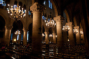 Stock  / Beautiful lighting inside of Notre-Dame Cathedral.
