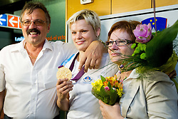 Urska Zolnir with her mother Majda and father Ljubo during reception of Slovenian Olympic team, on August 5, 2012 in Airport Joze Pucnik, Brnik, Slovenia. (Photo by Vid Ponikvar / Sportida.com)