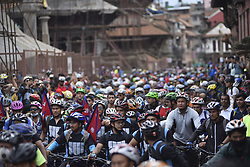 July 21, 2018 - Kathmandu, Nepal - Cyclists lining on a starting point to participate in Kathmandu Kora Cycling 2018 RIDE for a CAUSE at Patan Durbar Square, Patan, Nepal on Saturday, July 21, 2018. Riders from Nepal as well as from different countries participated to ride a challenge of 50 km, 75 km and 100 km around Kathmandu Valley on its eighth edition of KATHMANDU KORA. (Credit Image: © Narayan Maharjan/NurPhoto via ZUMA Press)