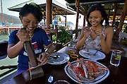 Ban Salak Phet. Salakpet Seafood restaurant. Office ladies from Bangkok having crab.