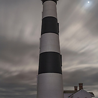 Bodie Island Lighthouse under a full moon. Cape Hatteras National Seashore, NC