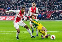 AMSTERDAM - Ajax - ADO , Voetbal , Eredivisie , Seizoen 2016/2017 , Amsterdam ArenA , 29-01-2017 ,  eindstand 3-0 , ADO Den Haag speler Trevor David (r) tikt de bal weg voor Ajax speler Mateo Cassierra (l) en Ajax speler Donny van de Beek (r)
