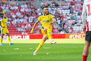 Luke O'Neill (#2) of AFC Wimbledon takes a free kick during the EFL Sky Bet League 1 match between Sunderland and AFC Wimbledon at the Stadium Of Light, Sunderland, England on 24 August 2019.