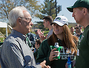 Hugh Sherman, the Dean of Ohio University's College of Business, left, talks with Jess Steele, the Director of Development in the College of Business, center, and Lee Beall, a member of the School of Accountancy Advisory Council, right, during the College of Business Homecoming tailgating event on October 10, 2015 at Ohio University's Tailgreat Park. Photo by Emily Matthews