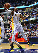 April 21, 2012; Indianapolis, IN, USA; Indiana Pacers power forward David West (21) snags a rebound against the Philadelphia 76ers at Bankers Life Fieldhouse. Philadelphia defeated Indiana 109-106. Mandatory credit: Michael Hickey-US PRESSWIRE