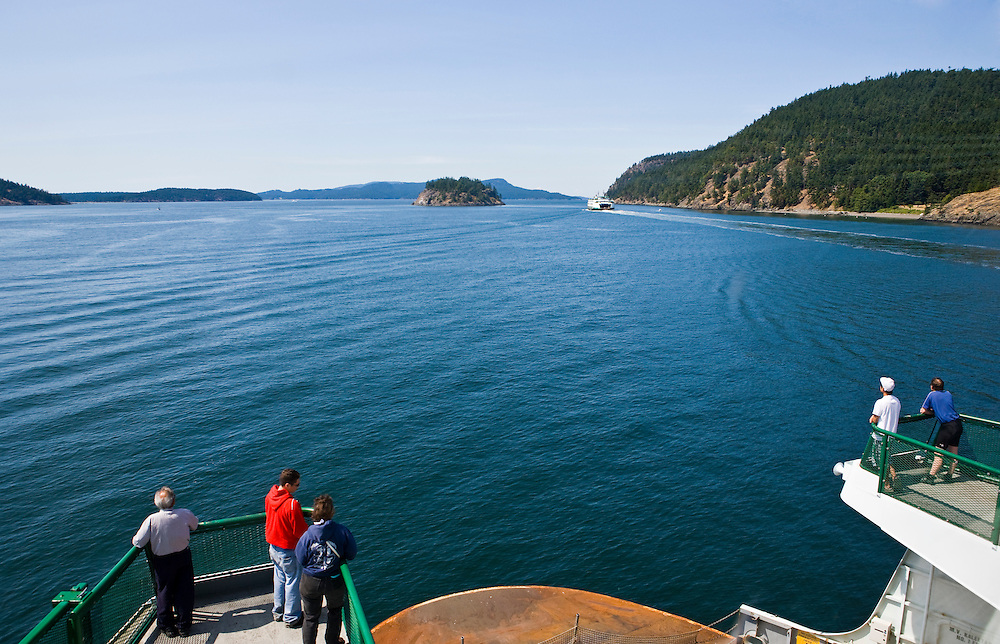 Looking out a window on a Washington State ferry in the San Juan Islands, Washington, USA.
