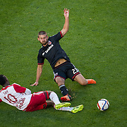 Nov 8, 2015; Harrison, NJ, USA; D.C. United midfielder/defender Perry Kitchen (23) slide tackles New York Red Bulls midfielder Lloyd Sam (10) during the second half of the MLS Playoffs at Red Bull Arena. Mandatory Credit: William Hauser-USA TODAY Sports