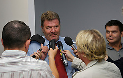Cardiff, Wales - Wednesday, October 10, 2007: Wales' manager John Toshack is interviewed by journalists as he arrives at Cardiff Airport as the team fly out for their Euro 2008 Qualifying matches in Cypress and San Marino. (Photo by David Rawcliffe/Propaganda)