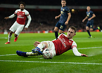 Football - 2018 / 2019 FA Cup - Fourth Round: Arsenal vs. Manchester United <br /> <br /> Aaron Ramsey (Arsenal FC) slides in to keep the ball alive  at The Emirates Stadium.<br /> <br /> COLORSPORT/DANIEL BEARHAM
