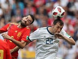 MOSCOW, July 1, 2018  Sergio Busquets (L) of Spain competes for a header with Artem Dzyuba of Russia during the 2018 FIFA World Cup round of 16 match between Spain and Russia in Moscow, Russia, July 1, 2018. (Credit Image: © Cao Can/Xinhua via ZUMA Wire)