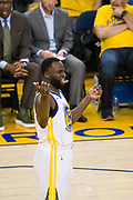 Golden State Warriors forward Draymond Green (23) reacts to being called for a foul against the Houston Rockets during Game 3 of the Western Conference Finals at Oracle Arena in Oakland, Calif., on May 20, 2018. (Stan Olszewski/Special to S.F. Examiner)