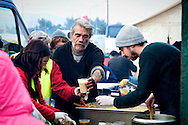 Volunteers prepare lunch for Refugees, by Aid Delivery Mission, organization based on voluntary that delivering aid to an ever changing & chaotic refugee crisis - Macedonian border, 8 Febraury 2016. Hundreds of refugees  wait every day at a gas station used as a temporary camp outside of Polykastro city at the north part of Greece until they receive the order from the police to move to the Greece- Macedonian border and continue their trip  to North Europe.