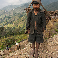 A boy carrying a traditional nepalese basket. Portrait taken between Pati Bhanjyang and  Thankuni Bhanjyang.