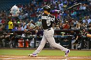 Apr 5, 2016; Phoenix, AZ, USA; Colorado Rockies outfielder Carlos Gonzalez (5) at bat against the against the Arizona Diamondbacks at Chase Field. The Arizona Diamondbacks won 11-6.  Mandatory Credit: Jennifer Stewart-USA TODAY Sports