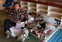 © under license to London News Pictures. 19/03/2011. A man made homeless by the tsunami that flattened Onagawa shows what few possessions he managed to salvage from the remains of his house.  Photo credit should read: London News Pictures