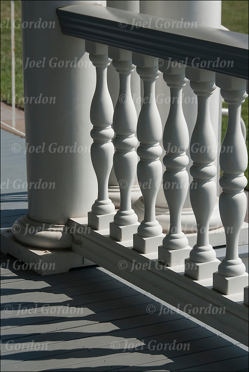 Close up  of  architectural design elements of repeating exterior white wooden baluster on he Absecon Lighthouse in Atlantic City, restored historic landmark originally built in 1857.