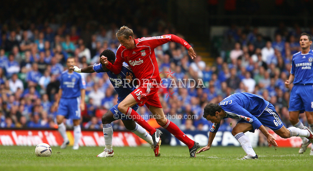 CARDIFF, WALES - SUNDAY, AUGUST 13th, 2006: Liverpool's Peter Crouch in action with Chelsea's Michael Essien during the Community Shield match at the Millennium Stadium. (Pic by David Rawcliffe/Propaganda)