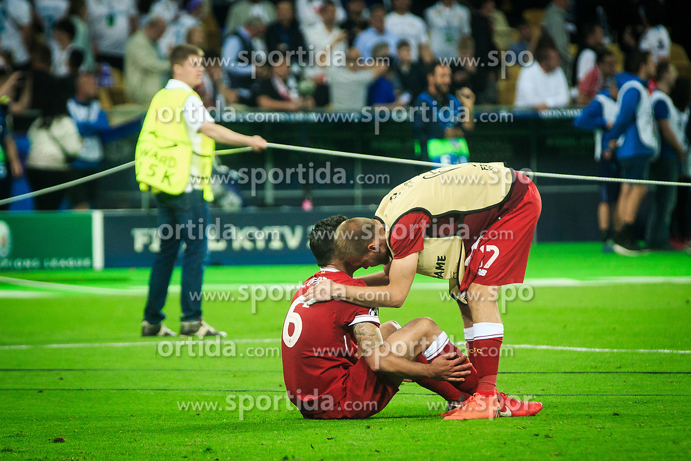 Dejan Lovren and Ragnar Klavan of Liverpool look dejected after the UEFA Champions League final football match between Liverpool and Real Madrid and became Champions League  2018 Champions third time in a row at the Olympic Stadium in Kiev, Ukraine on May 26, 2018.Photo by Sandi Fiser / Sportida