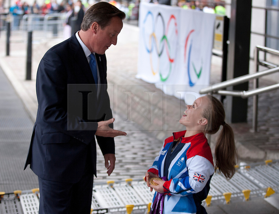 © Licensed to London News Pictures. 10/09/2012. LONDON, UK. The British Prime Minister, David Cameron, talks to gold medal winning Paralympic Athlete Ellie Simmonds as they both arrive at a reception for British Paralympic and Olympic athletes held at the Queen Elizabeth II Conference Centre in London today (10/09/12). Photo credit: Matt Cetti-Roberts/LNP