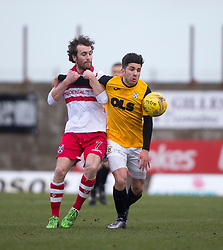 Stirling Albion's Mark Lamont and East Fife&rsquo;s Kyle Wilkie. <br /> Half time : East Fife 0 v 0 Stirling Albion, Scottish Football League Division Two game played atBayview Stadium, 20/2/2106.
