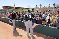GLENDALE, AZ - FEBRUARY 28:  Carlos Quentin #20 of the Chicago White Sox signs autographs prior to the game against the Los Angeles Dodgers on February 28, 2011 at The Ballpark at Camelback Ranch in Glendale, Arizona. The Dodgers defeated the White Sox 6-5.  (Photo by Ron Vesely)