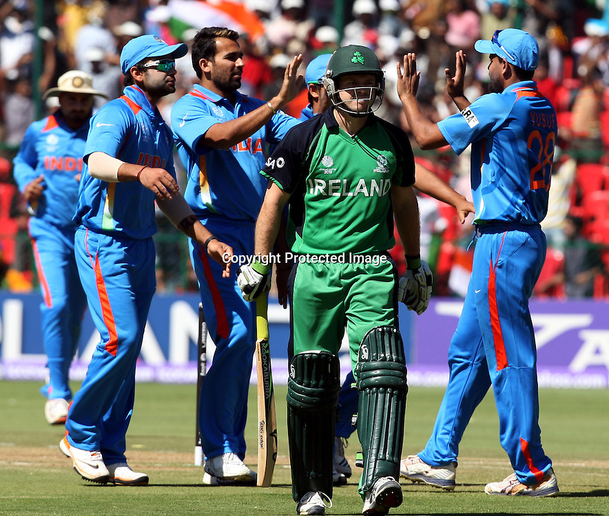 Indian bowler Zaheer Khan celebrates with team mates Ireland batsman Ed Joyce wicket during the ICC Cricket World Cup - 22nd Match, Group B, India vs Ireland Played at M Chinnaswamy Stadium, Bangalore, 6 March 2011 - day/night (50-over match)