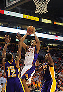 Oct. 29 2010; Phoenix, AZ, USA; Phoenix Suns guard-forward Josh Childress (1) puts up a basket against Los Angeles Lakers guard-forward Shannon Brown (12) and teammate forward Lamar Odom (7) during the second quarter at the US Airways Center. Mandatory Credit: Jennifer Stewart-US PRESSWIRE.