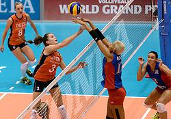 08-08-2014 NED: FIVB Grand Prix Nederland - Puerto Rico, Doetinchem<br /> Yvon Beliën slaat de bal in het blok van Ocasio