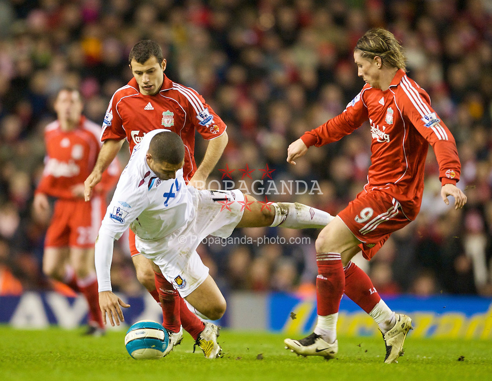 LIVERPOOL, ENGLAND - Wednesday, March 5, 2008: Liverpool's Javier Mascherano and Fernando Torres tackle West Ham United's Hayden Mullins during the Premiership match at Anfield. (Photo by David Rawcliffe/Propaganda)