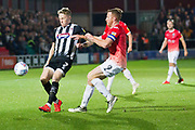 Grimsby Town defender Luke Hendrie challenged by Salford City forward Adam Rooney during the EFL Sky Bet League 2 match between Salford City and Grimsby Town FC at Moor Lane, Salford, United Kingdom on 17 September 2019.