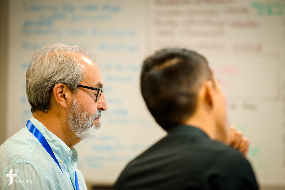 The Rev. Dr. Arthur Just and Kevin Kong listen during missionary orientation at the International Center of The Lutheran Church–Missouri Synod on Wednesday, July 12, 2017, in St. Louis.  LCMS Communications/Erik M. Lunsford