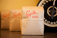 Spella Caffe, a tiny, Italian style coffee shop in downtown Portland, Oregon specializes in traditional espresso and espresso drinks using their own roasted coffee beans.  Pictured here are the half pound bags of Spella's espresso blend.