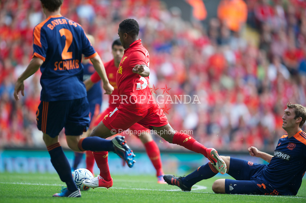 LIVERPOOL, ENGLAND - Sunday, August 12, 2012: Liverpool's Raheem Sterling scores the first goal against Bayer 04 Leverkusen during a preseason friendly match at Anfield. (Pic by David Rawcliffe/Propaganda)