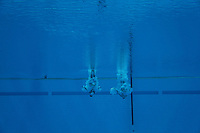 Competitors warm up during the synchronized 10m platform diving final during day 4 of the London Olympic Games London, 31 Jul 2012..(Jed Jacobsohn/for The New York Times)....